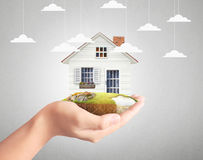 Holding house representing home ownership Stock Image