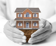 Holding house representing home ownership Stock Photo