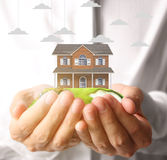 Holding house representing home ownership Royalty Free Stock Image