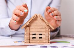 Holding house representing home ownership and the Real Estate business Royalty Free Stock Photo