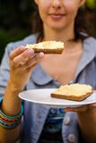 Holding hummus sandwich. Woman holding hummus sandwich and looking royalty free stock photos