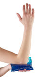 Holding ice gel pack on elbow. Stock Photos