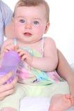 Holding infant Stock Photography