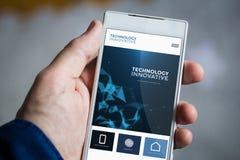 Holding innovative website smartphone Stock Photo