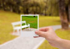 Holding Instant photo. Royalty Free Stock Photography