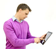 Working on an ipad. Holding an ipad and pointing or working on screen Royalty Free Stock Image