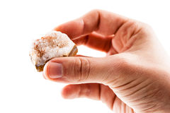 Holding a jasper stone. A male hand holding a fragment of jasper mineral isolated on a white background Stock Image