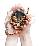 Holding the jewelry. Holding the handmade jewelry in hands Stock Images