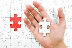 Holding a Jigsaw Piece Stock Photo