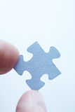 Holding jigsaw piece Stock Image