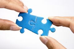 Holding Jigsaw Puzzle Stock Photo