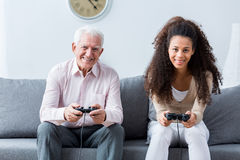 Holding joysticks and playing games Stock Photography