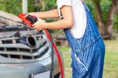 Holding jumper cables Royalty Free Stock Photo