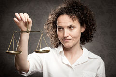 Holding justice scale Royalty Free Stock Photography