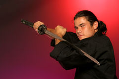 Holding katana Stock Photo