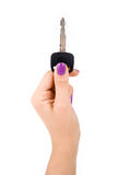 Holding the Key. Female holding the car key royalty free stock photos