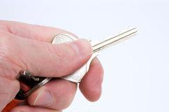 Holding the key. A hand holds a single key stock photography
