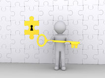 Holding the key to the solution. 3d person holding a golden key in front of puzzle wall Royalty Free Stock Image