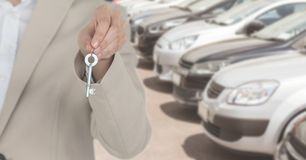 Holding Keys with cars. Digital composite of Holding Keys with cars Stock Photography