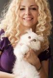 Holding kitten Stock Photo