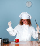 Holding knife angry female cook Royalty Free Stock Photo