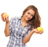 Holding a lemon and an apple Royalty Free Stock Image