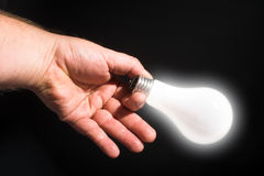Holding a Light Bulb Royalty Free Stock Photos