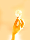 Holding a light bulb. Man hand holding a light bulb. Light warmth background. Representing ideea, solution stock photos