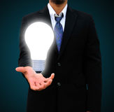 holding light bulb Stock Photo