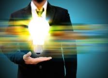 holding light bulb Stock Images