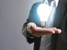 Holding light bulb in hand Stock Image