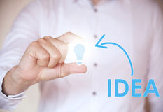 Holding a light bulb idea concept Stock Photos
