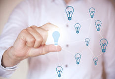 Holding a light bulb Royalty Free Stock Photography