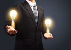 Holding light bulb power of thinking Stock Image