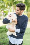Holding little dog Royalty Free Stock Photo