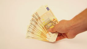 Holding lots of euro banknotes stock video footage