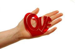 Holding love woman. Woman hand holding word love Royalty Free Stock Photography