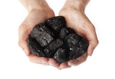 Holding lumps of charcoal in hands Stock Photography