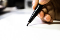 Holding magic pen on canvas paper. Hand holding marker pen closeup view on white background royalty free stock image