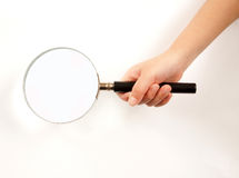 Holding a magnifying glass Royalty Free Stock Photography