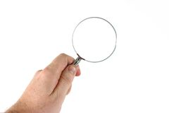 Holding a magnifying glass. A handon white background holding a magnifying glass Stock Photos