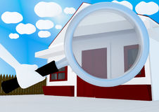 Holding a magnifying glass towards a house Royalty Free Stock Photos