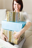 Holding many gifts Royalty Free Stock Images