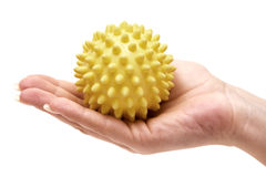 Holding a Massage Ball Royalty Free Stock Images