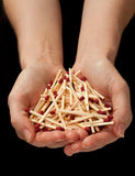 Holding matches on black background Royalty Free Stock Photo
