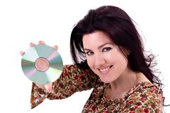 Holding Media. Beautiful young woman holding a CD / DVD / Media Disc Stock Photo
