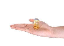 Holding medical vial Stock Photo