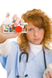 Holding medicine Royalty Free Stock Images
