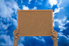Holding a message board Stock Photo