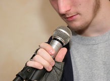 Holding Microphone Royalty Free Stock Photo